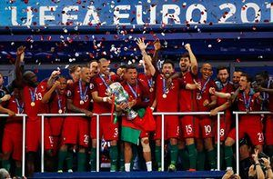 Ronaldo limps, wince and lifts the trophy with his team-mates